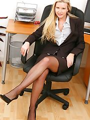 Big Tits at Work, Breathtaking blonde secretary in smart black skirt suit.