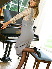 Stunning Loora strips out of her secretary outfit by her piano