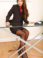 Office Babe, Michaela looks delightful as she slowly removes her sexy skirt suit to reveal her gorgeous black stockings and suspenders