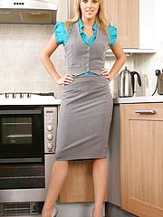Office Sex, Mackenzie dressed in a grey secretary outfit with a blue blouse and beige stockings.