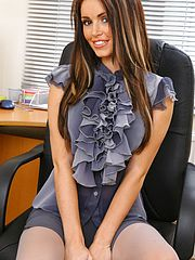 Gemma Massey slowly removes her miniskirt and silk blouse.